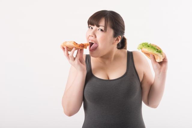 肥満・ハンバーガーを食べる・女